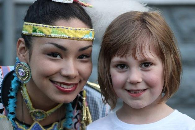 native posing with little girl